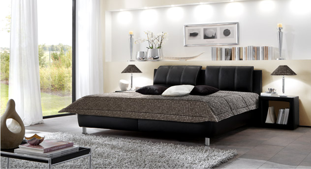 schwarzes polsterbett mit verstellbarem kopfteil carisio. Black Bedroom Furniture Sets. Home Design Ideas