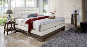 Boxspringbett im industrial Luxus-Schlafzimmer Cueno