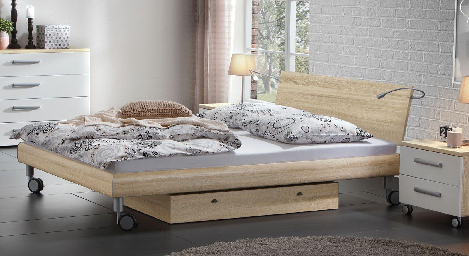 Bett Antia in sägerauer Eiche ohne Kopfteilpolster