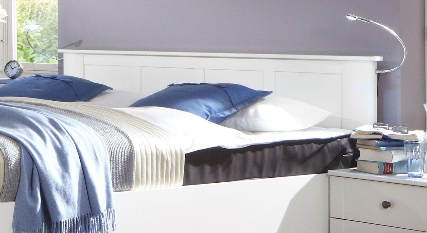 Bett Berata mit kunstvollem Kopfteil