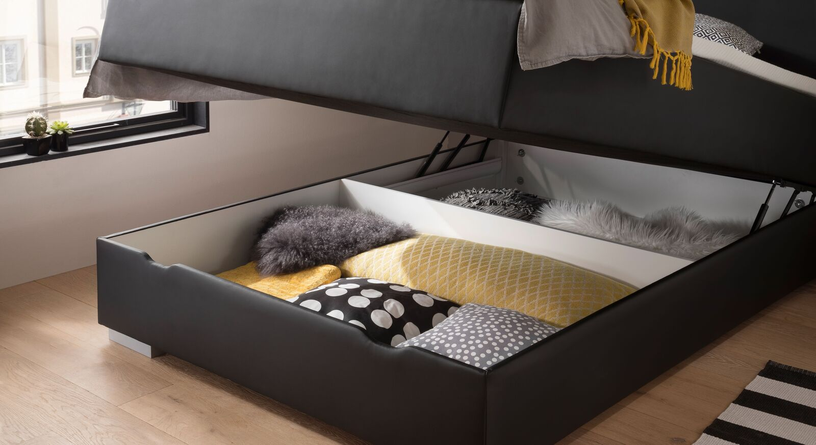 Bettkasten-Boxspringbett Merwin mit geräumigen Bettkasten