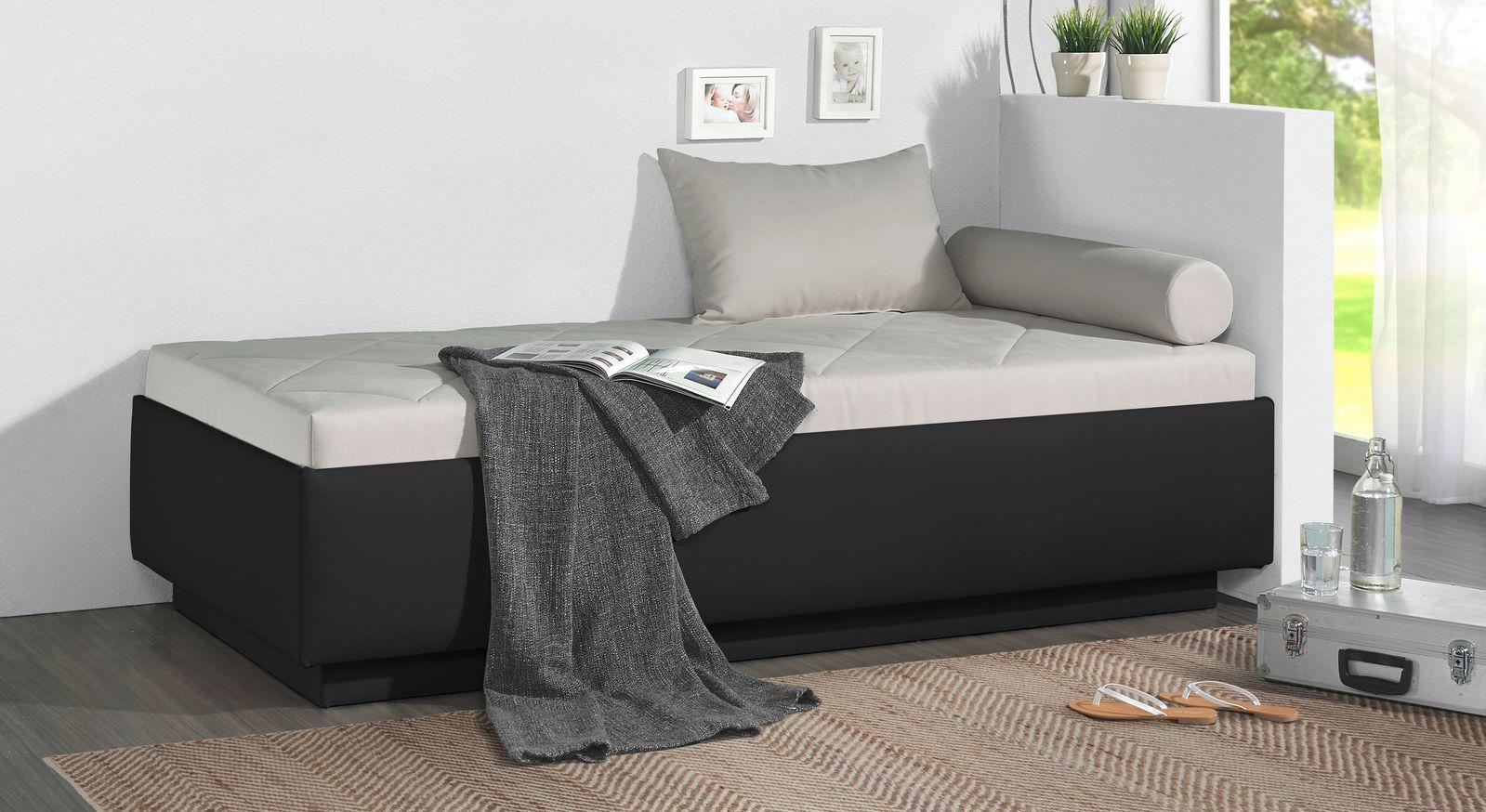 Relaxliege Eriko aus schwarzem Kunstleder und hellgrauem Microvelours